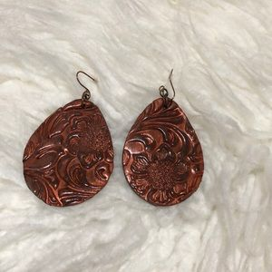 Tooled leather earrings.